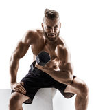 Strong sportsman working out with dumbbells. Photo of muscular man isolated on white background. Strength and motivation Royalty Free Stock Image