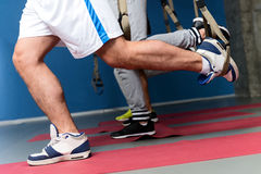 Strong sportsmen exercising in gym Stock Photography