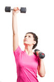 Strong sporty woman training her shoulders with black barbells Royalty Free Stock Photos