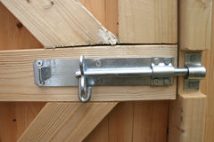 Strong Steel Bolt. On Wooden Gate royalty free stock image