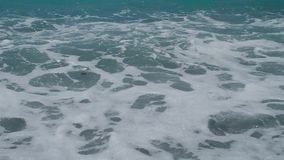 Strong sea wave with white foam. Strong storm sea wave with white foam. Full HD 1920x1080 30p stock video