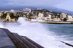 Strong storm on the Yalta embankment. Splash wave. royalty free stock images