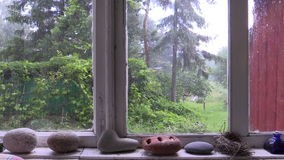 Strong summery hail through the wooden window in rural house stock video