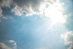 Strong sun burst out of cloud Royalty Free Stock Photos