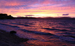 Strong sunset colors. Strong and vibrant sunset on the bay in Tasmania, Australia royalty free stock photo