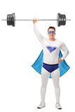 Strong superhero lifting a heavy barbell Stock Photography