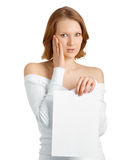 Strong surprise on her face. Girl with a sheet of paper in her hand and strong surprise on her face Stock Photos