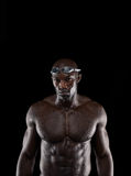 Strong swimmer with perfect physic. Portrait of strong young male swimmer posing for camera with copy space. African professional athlete with wet body against Stock Image