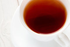 Strong tea in a white cup Royalty Free Stock Image