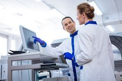 Two budding laboratorians working together stock images