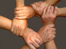 Strong Team Work. Strong man's arms making unbreakable strong team work Royalty Free Stock Photos