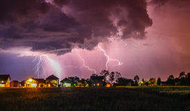 Strong Thunder hitting house with rain over the village street Stock Photography