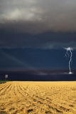 Strong thunder-storm above the  oblique  field Stock Images