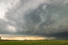 Strong thunderstorm with ominous sky in north central Nebraska. Besides vivid lightning, large hail occured with this storm, a few dozens of miles southeast of royalty free stock image