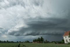 Wallcloud of a rotating supercell thunderstorm over the countryside of eastern Flanders, Belgium royalty free stock photo