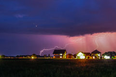 Strong Thunderstorm with rain over the village street Stock Photos