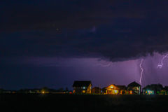 Strong Thunderstorm with rain over the village street Stock Photo