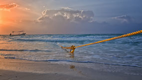 Strong ties. Anchor rope on fishing vessel in caribean sea, taken on the coast of Mexico Stock Image