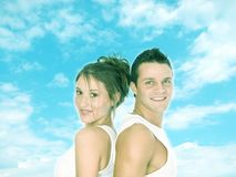 Strong together. Attractive young couple smiling with confidence on a sky background royalty free stock images