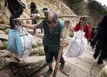 Strong, tough porter on  Huangshan - Yellow Mountain, China Royalty Free Stock Photos