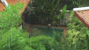 Strong tropical downpour in Thailand stock footage video stock footage