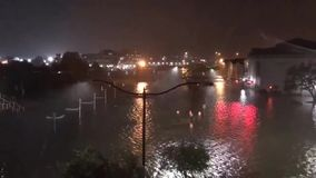 A strong tropical hurricane flooded the city, the streets in the water. 1080 stock video footage