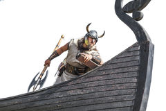 Strong Viking on his ship. Angry man with historical weapon and helmet on ship looking. and ready to attack Royalty Free Stock Photo