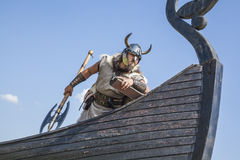 Strong Viking on his ship looking to beach Royalty Free Stock Images