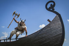 Strong Viking jumping from his ship to attack Royalty Free Stock Photo