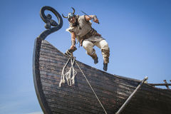 Strong Viking jumping from his ship to attack Royalty Free Stock Images