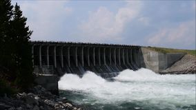 Strong water flow from Jackson lake dam stock video footage