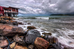 Strong wave and dramatic clouds Royalty Free Stock Image