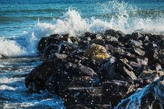 Strong wave of  sea beats on the rocks royalty free stock photography