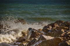 Strong wave of  sea beats on the rocks.  royalty free stock photos