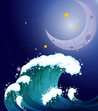 A strong wave under the moon Stock Photo