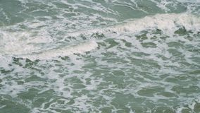 Strong waves crash on a windy day. Strong waves crash into each other on a windy day just before storm stock video