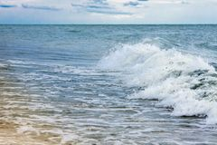 Strong waves crash over the beach at Sea of Azov stock photo
