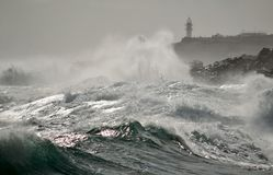 Strong waves  and lighthouse Royalty Free Stock Photo