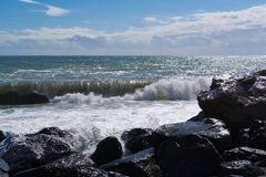 Strong waves at sea. Strong waves in the sea cut into rocks Stock Photo