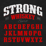 Strong whiskey label font with sample design Royalty Free Stock Photo
