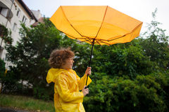 Strong wind has wrest an umbrella in boy's hands. Stock Images