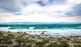 Strong wind, sea waves and the coast or beach. Dramatic photo of thunderstorm and strong winds hitting the coast of island Silba in Croatia Stock Photography