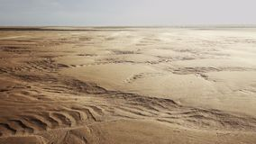 Wind blowing sand over scenic dunes