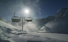 Strong wind storm chair lifts do not work on top of ski resort Gorky Gorod 2200 meters above sea level Royalty Free Stock Photo