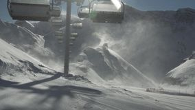 Strong wind storm chair lifts do not work on top of ski resort Gorky Gorod 2200 meters above sea level stock footage stock video footage