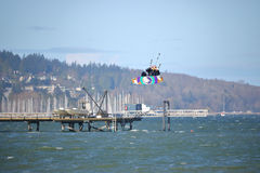 Strong Winds Launches Kite Surfer into Air. Kite Surfing on English Bay and, with the help of gale force winds, an avid surfer is launched high into the air in Royalty Free Stock Photo