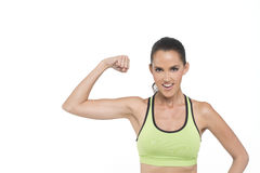 Strong woman. A happy fit woman flexing her muscles, photographed in studio Stock Photos