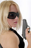 Strong woman with black gun Stock Image