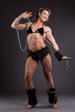 Strong woman body builder posing with chain Stock Photo