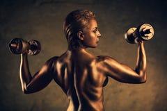 Strong woman bodybuilder Stock Photos